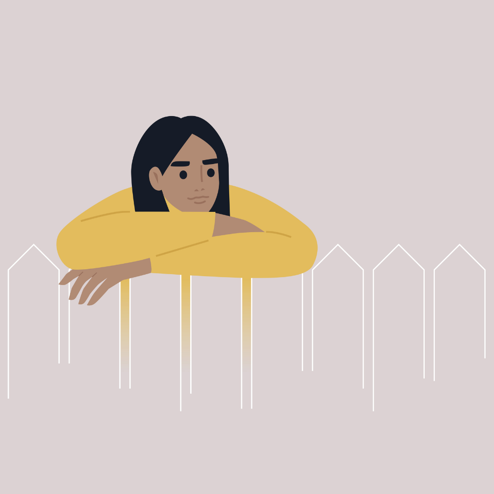 A person leaning over a picket fence